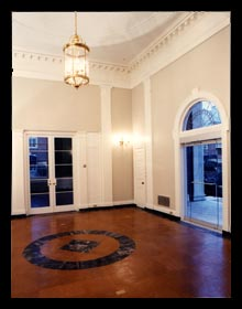 Renovated entry hall for the Albemarle County Historical Society in Charlottesville, Virginia with new cork flooring and doors, designed by architect Candace Smith, AIA