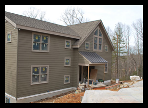 Contemporary new residence under construction in Albemarle County, Virginia, with custom windows at stair well and open A-frame roof at loft and great room, designed by Candace M.P. Smith Architect