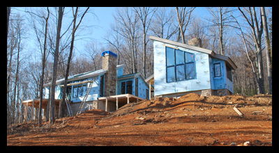 Modern new residence under construction in Albemarle County, Virginia, with outdoor fireplace and mountain views, designed by Candace Smith Architect