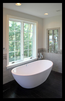 New master suite with free-standing bath tub, custom shower and tile wainscot for residence in Charlottesville, Virginia, designed by Candace M.P. Smith Architect