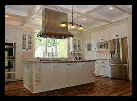 Custom kitchen with coffered ceiling, antique flooring and large custom island for residence in Charlottesville, Virginia, designed by Candace M.P. Smith Architect