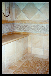 Custom shower with mosaic jerusalem limestone, bench and steam enclosure designed for home in Charlottesville, Virginia, by Candace Smith, AIA