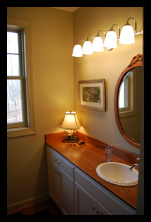 Custom vanity with natural wood counter for guest bath addition for residence in Virginia designed by Candace M.P. Smith Architect