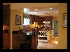 New kitchen, lighting, wine rack and island for existing house in Albemarle County, designed by Candace Smith Architect
