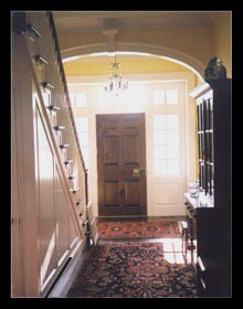 New stair paneling arched opening and entryway designed for new house in Virginia by architect, Candace Smith, AIA